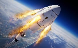 Cette illustration mise à disposition par SpaceX représente la capsule Crew Dragon et la fusée Falcon 9 de la société pendant le test d'interruption en vol sans équipage pour le programme d'équipage commercial de la NASA.
